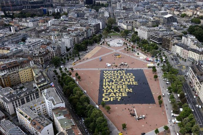 "Meet the world's largest poster ever. As to the answer to the question, a number of people would likely immediately proceed to party. The poster unfortunately fails to ask ""who is going to pay for it?"" – or better said, who will be robbed at gunpoint to pay for it. Photo credit: AFP"