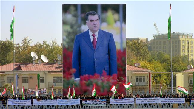 Look at him! How can one not love him! Below the modestly sized image of dear leader Emomali Rahmon, the citizens of Dushanbe are partying to express their joy at the outcome of the recent referendum. Photo credit: AFP