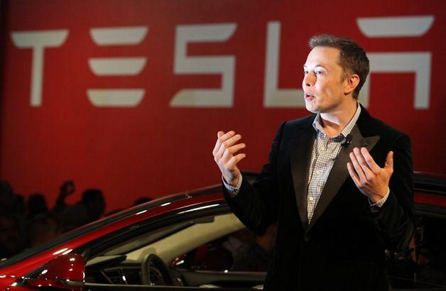 Come on in… Elon Musk at a Tesla presentation. Photo credit: Matt Sumner / ZUMAPRESS