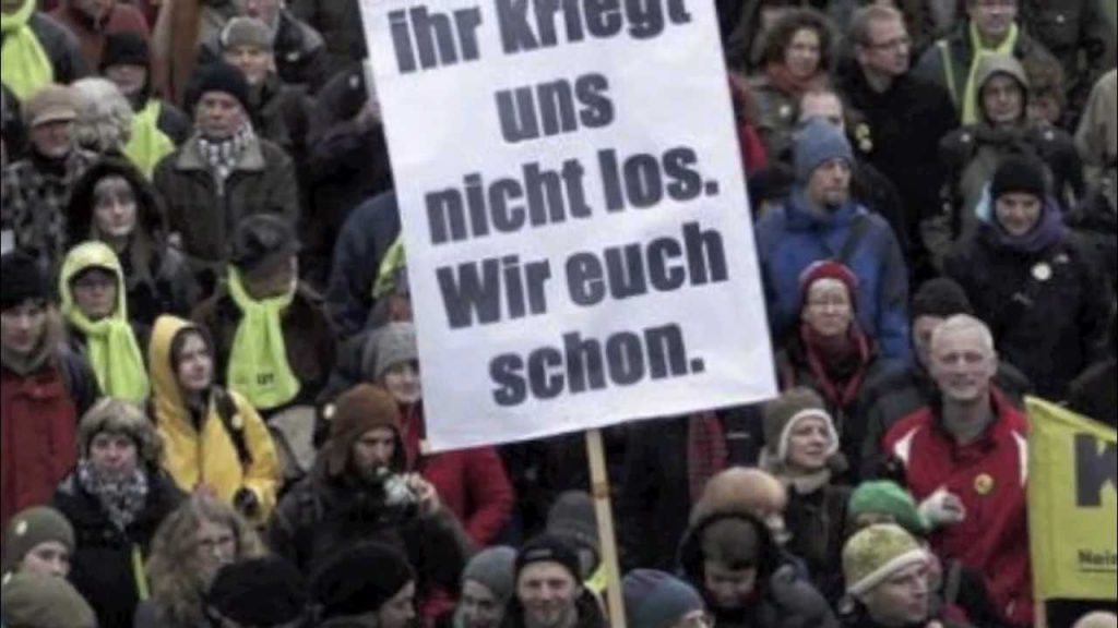 """The sign is evidently addresses the political class directly. It reads: """"You won't get rid of us – we'll get rid of you though""""."""