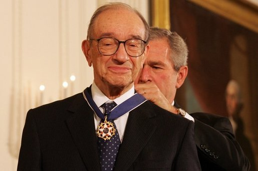He was in it for the power and the glory… Alan Greenspan gets presidential bling affixed to his neck by GW Bush, the English language mangler Photo credit: Shealah Craighead