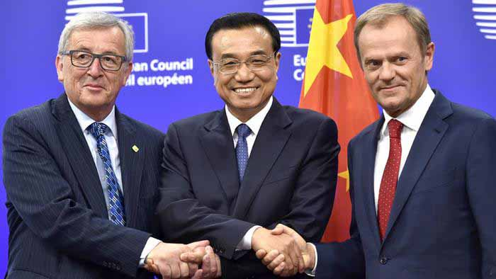 """China's economy czar & prime minister Li Keqiang, JC """"not quite present & often befuddled"""" Juncker, and a perplexed looking Donald Tusk are shaking hands on a new trade deal in Beijing. Only one of them looks really happy, so it seems the Chinese got the better of the Europeans, and the two EC minions appear to be well aware of it. In fact, we have it on good authority that later that day, in the hotel bar, a slightly tipsy JC remarked (in French): """"Donnie, they pulled a fast one on us. I know it!"""" Tusk is said to have replied: """"Can you say that again in English please?"""" Photo credit: Yves Herman / Reuters"""