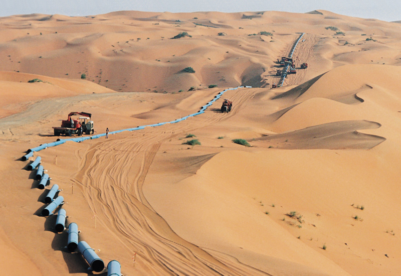 A new oil pipeline is built in the Saudi desert… this one is apparently destined for the Ghawar oil field, one of the oldest fields in Saudi Arabia and still the largest in the world Photo credit: Saudi Aramco