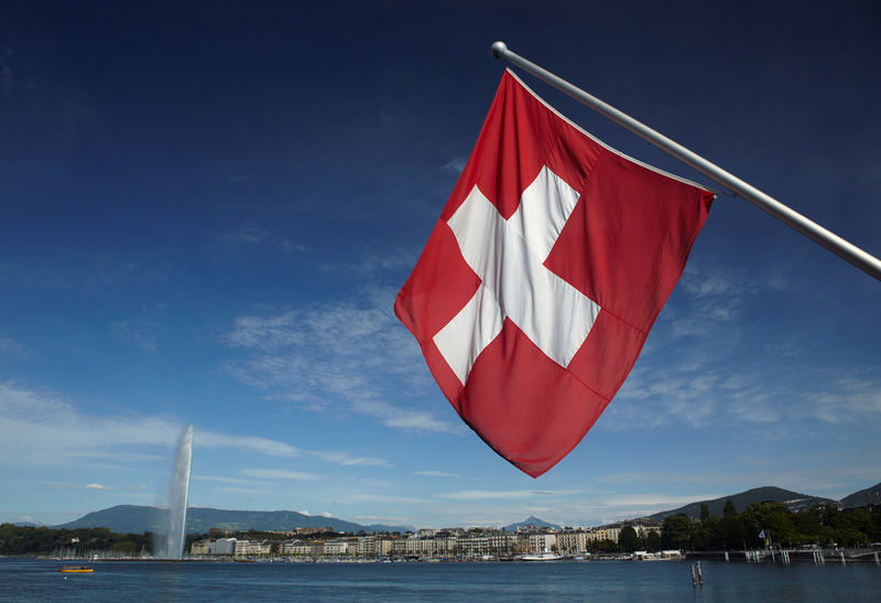 Swiss flag is pictured next to Jet d'Eau and Lake Leman from the St-Pierre Cathedrale in Geneva