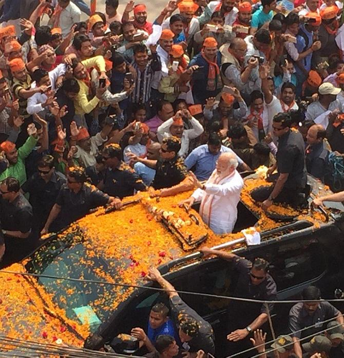 The Modimobile is making the rounds amid a flower shower. [PT] Photo credit: PTI Photo