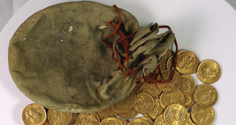 pouch of gold coins from piano