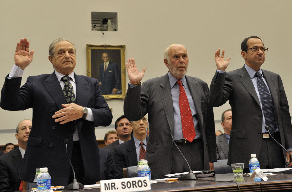 John Paulson (far right), along with Jim Simons of Renaissance (middle) and George Soros (left)