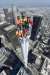 Iron workers (the non-distraught variety) atop the 10 ton spire of the Wilshire Grand Center in Lost Angeles.