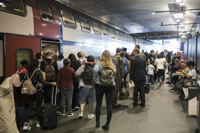 Passengers Boarding a Train in Bern Station